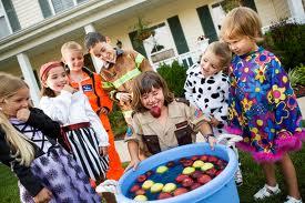 Children bobbing for apples