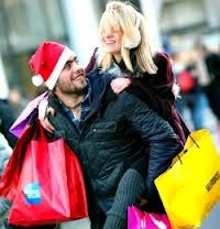 Black Friday shoppers man and woman with many bags