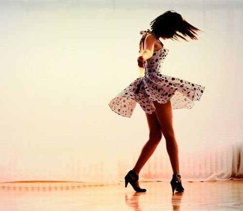 Woman dancing in a polka dot dress