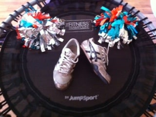 Cheer shoes and pom poms on JumpSport Fitness trampoline used by Heidi for training
