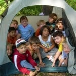 Kids having fun camping in a tent