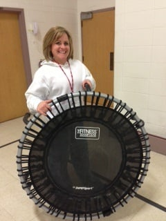 Erin Swick-Washkuhn with a JumpSport Fitness trampoline she uses with students