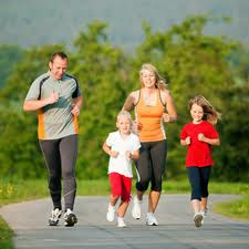 Family running on a path exercising together