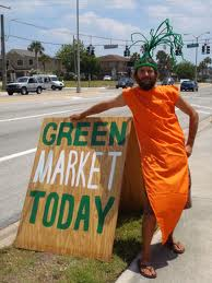 Green market promotion with man in carrot costume