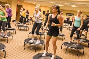 JumpSport Fitness trampoline training class with women using trampolines