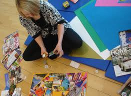 Girl on the floor creating a vision board