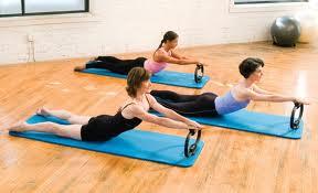 Three women using Pilates Magic Circles