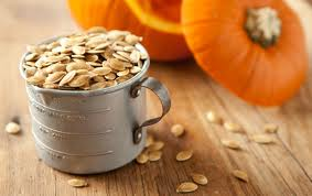 Pumpkin seeds in a measuring cup