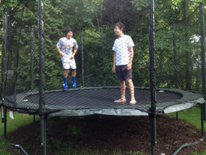 Kids jumping on outdoor trampoline