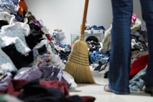 Person sweeping and cleaning up clutter