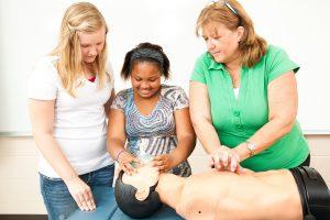 Children learning CPR basics
