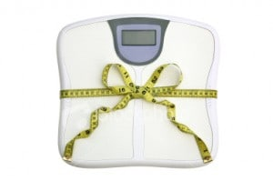 Fitness scale wrapped in a tape measure