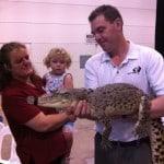 Stevie teaching me to pet a crocodile named Charlie