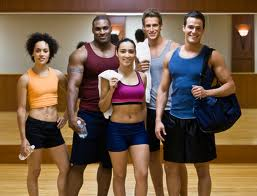 Group of people in workout clothes at the gym